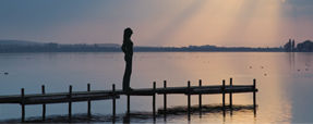 Woman Standing on Docks